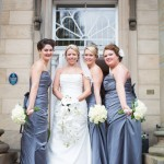 Bride has white phalaenopsis orchids and bridesmaids have norma jean roses